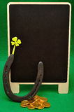 A shamrock, horse shoe and golden coins Royalty Free Stock Photo