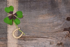 Shamrock and horseshoe on wooden background for New Year's Eve/S Royalty Free Stock Photography