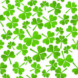 Shamrock Leaves Pattern. Seamless Background with Green Shamrock Leaves Made in Flat Style. Isolated Trefoil Foliage for St.Patricks Day Design. Vector EPS10 Stock Images