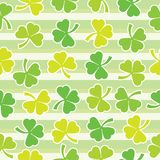 Shamrock leaves seamless pattern on green striped background suitable for St Patrick Day& x27;s scrap paper. Shamrock leaves seamless pattern on green striped vector illustration