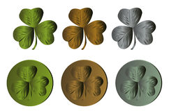 Shamrock leaves. Three shamrock leaves in metallic shades and the same as medals Royalty Free Stock Image