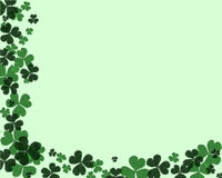 Shamrock part border. Raised and partly textured Shamrocks (part border) on a pale green background Royalty Free Stock Photo