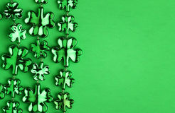 Shamrock Shaped Shiny Leaves over Green. St. Patrick's Day stock photography