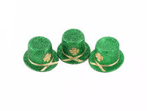 Shamrock and Top Hat. Three different shamrocks with glittering top hat on white Stock Photos