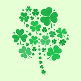 Shamrock vector shape made with green flat shamrocks. Shamrock shape made with small green flat shamrocks. Vector st patricks concept illustration Stock Image