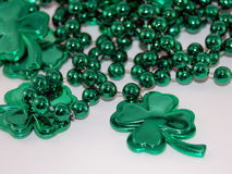 Shamrocks. A necklace of green metallic beads and plastic shamrocks Royalty Free Stock Images