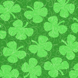 Shamrocks  on a Background of Green Curlicues Royalty Free Stock Photo