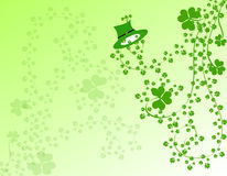Shamrocks and a hat. Green shamrocks foliage and a hat for St Patrick day celebration Royalty Free Stock Image