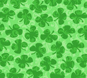 Shamrocks Scattered on a Green Swirl Background Royalty Free Stock Photography