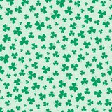 Shamrocks seamless pattern. Hand drawn seamless vector pattern with shamrocks, on a green background. Design concept for Saint Patrick`s day celebration, kids Royalty Free Stock Photos