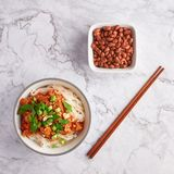 Shan noodles with peanuts and chopsticks at white marble tabletop. burmese cuisine traditional dish. Myanmar food. rice noodles with pork in tomatos royalty free stock photo