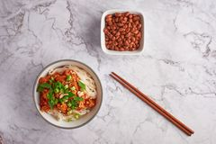 Shan noodles with peanuts and chopsticks at white marble tabletop. burmese cuisine traditional dish. Myanmar food. rice noodles with pork in tomatos stock photos