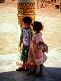 Kids captivated, observing from a shady corner of a bhuddist monastry, Trek Kalaw Inle Lake, Shan State, Myanmar Royalty Free Stock Image