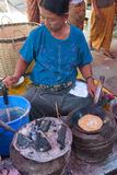 Shan woman makes flat breads Royalty Free Stock Image