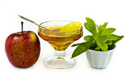 Shana tova vemetuka. Apple and honey are symbols of Jewish New Year (Rosh hashana Stock Photography