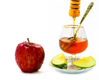 Shana tova vemetuka. Apple and honey are symbols of Jewish New Year (Rosh hashana Royalty Free Stock Photos