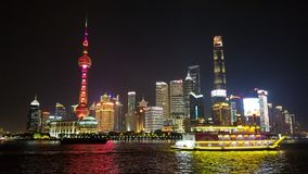 Shangai dark skyline and boat stock images