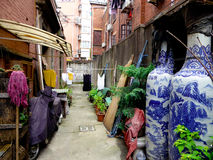 Shanghai alley. Shanghai old narrow alley with clothes hung and filled with debrisin in Shanghai China stock photography