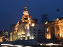 Shanghai The Bund. The clock tower of the former Customer House is one of the famous landmark in The Bund in Shanghai Stock Photography