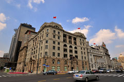 Shanghai Bund buildings and street under sky. Landmark buildings and street view in Shanghai Bund, China, which is Shanghai Peace Hotel and shanghai bank, shown Royalty Free Stock Photo