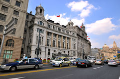 Shanghai Bund Street and buildings, China. China Shanghai Bund street view and aged business buildings under blue sky, shown as Shanghai city view as economy Stock Images