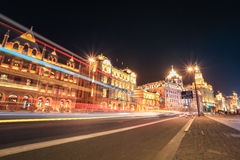 Shanghai bund street at night. Shanghai bund at night ,excellent historical buildings with vehicle trails of light on the street Royalty Free Stock Photos