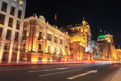 Shanghai bund streets at night. Shanghai bund at night ,outstanding historical buildings with vehicle trails of light on the street Royalty Free Stock Photography