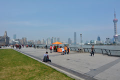 Shanghai - The Bund or Waitan. SHANGHAI, CN - MAR 17 2015:Visitors on Shanghai - The Bund or Waitan.Shanghai Bund has dozens of historical buildings and It is Royalty Free Stock Photo