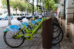 The SHANGHAI, CHINA - APRIL 2017: Green public bycicle Stock Photos