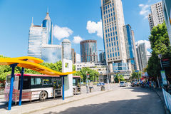 Modern buildings and bus stop in Shanghai, China. Shanghai, China - August 8, 2016 : Modern buildings and bus stop under blue sky Royalty Free Stock Photo