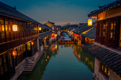 SHANGHAI, CHINA: Beautiful evening light creates magic mood inside Zhouzhuang water town, ancient city district with. Channels and old buildings, charming stock photo