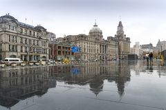 SHANGHAI, CHINA - December 28, 2017: Historical architecture on. The bund of Shanghai with reflection of buildings on rain, waterfront of the Huangpu River is a Royalty Free Stock Image