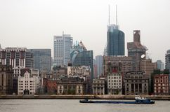SHANGHAI, CHINA - Embankment of Huangpu river and old buildings in the Bund Royalty Free Stock Photos