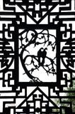 Dove carving on an ornate wooden window at Yuyuan Garden, Shanghai. SHANGHAI, CHINA - FEB 2, 2015 - Dove design in a wooden window frame at Yuyuan garden stock photography
