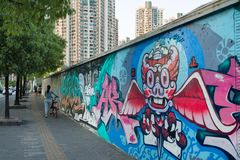 Nice Graffiti and Street Art in Mogahnshan road and modern buildings in Putuo district. Residential skyscrapers in Shanghai. Shanghai, China - 08 18 2016 royalty free stock photo
