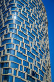 SHANGHAI, CHINA - 29 JANUARY, 2017: Modern building facade of glass and artistic design, square pattern window fames Royalty Free Stock Image