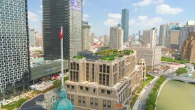SHANGHAI, CHINA - JULY 2016: Aerial drone view of shanghai post office tower with clocks, sculpture