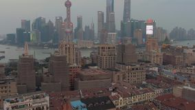 Shanghai, China - March 22, 2018: Haungpu and Lujiazui District. China. Aerial View. Drone Flies Forward, Tilt Up