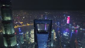SHANGHAI, CHINA - MAY 5, 2017 Aerial drone video, night time illuminated famous pudong cityscape