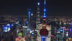 SHANGHAI, CHINA - MAY 5, 2017 Aerial drone video, night time illuminated famous pudong cityscape. Business finance centre skycreapers skyline, Huangpu river stock video footage