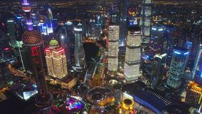SHANGHAI, CHINA - MAY 5, 2017 Aerial drone video, night time illuminated famous pudong cityscape stock video