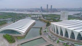 SHANGHAI, CHINA - MAY 6, 2017: Aerial video of Shanghai Oriental Sports Center 4K fog, dusk stock video footage