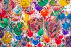 Background of balloons with cartoon characters. Shanghai Disneyland is a famous tourist and popular family holiday destination in stock photos