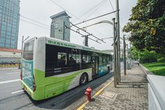 Electric powered hybrid bus in Shanghai, China. SHANGHAI, CHINA - MAY 05, 2016: Electric powered hybrid bus charging royalty free stock images