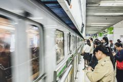 People waiting train in Shanghai metro, China. SHANGHAI, CHINA - MAY 08, 2016: Shanghai metro. People waiting a train Royalty Free Stock Image