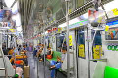 Shanghai, china metro train interior. Interior view of shanghai, china metro train with commuters Stock Image