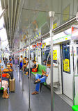 Shanghai, china metro train interior. Interior view of shanghai, china metro train with commuters Royalty Free Stock Image
