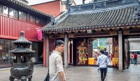At the 600-year-old Old City God Temple, Shanghai, China. Shanghai, China - Nov 6, 2016: Gate to the 600-year-old Old City God Temple. Paintings of the City Gods royalty free stock photos