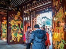 At the 600-year-old Old City God Temple, Shanghai, China. Shanghai, China - Nov 6, 2016: Gate to the 600-year-old Old City God Temple. Paintings of the City Gods royalty free stock photography