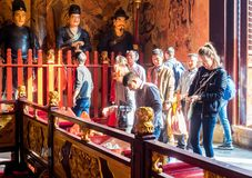 At the 600-year-old Old City God Temple, Shanghai, China. Shanghai, China - Nov 6, 2016: Inside the 600-year-old Old City God Temple. Visitors enter the main royalty free stock photos